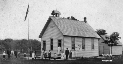 Tracie Balitz, standing third left of teacher, Platte school, circa 1906. Also, Lottie Arnold, white dress just right of teacher; and Ernie Balitz, probably third from left.
