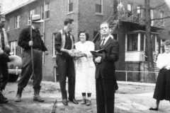 Doris Jane Arnold and firiends holding funeral for a goldfish, perhaps at Owosso Bible College, circa 1950.